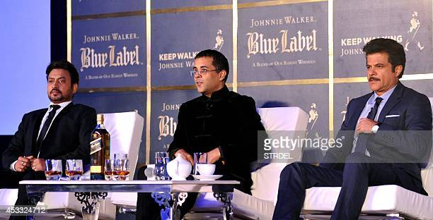 Indian author and screenwriter Chetan Bhagat speaks with Bollywood actors Anil Kapoor and Irrfan Khan during a promotional event in Mumbai late...