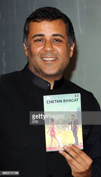 Indian author columnist and screenwriter Chetan Bhagat poses for a photograph during a promotional event for the forthcoming Hindi film 'Half...