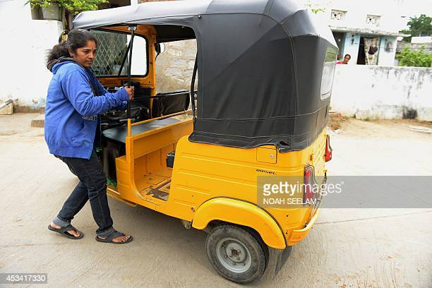 Indian auto rickshaw driver Vennapusa Narayanamma manouvers her auto rickshaw outside her home in the Nijampet District on the outskirts of Hyderabad...