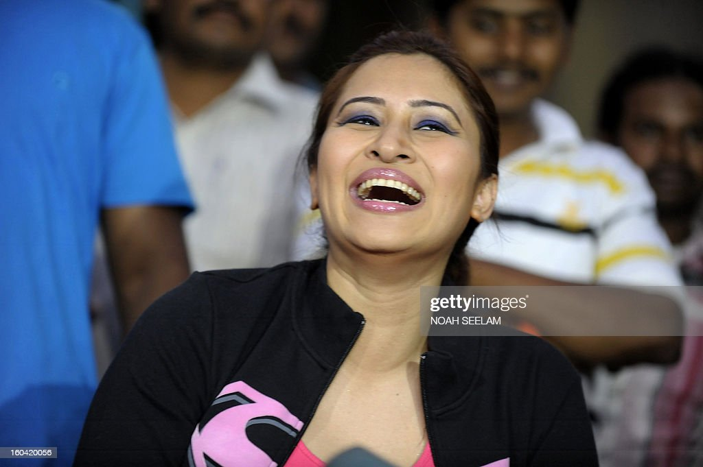 Indian badminton player Jwala Gutta faces the press after participating in a film shoot at Sarathi Studios in Hyderabad on January 31, 2013. Jwala announced her acting career in Telugu regional film of Southern Indian state of Andhra Pradesh in a 'special song' in a dance number for a Telugu film. AFP PHOTO / Noah SEELAM