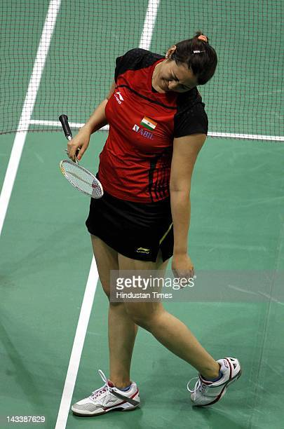 Indian badminton player Jwala Gutta in action against Chinese pair of Tao Jaiming and Xia Huan during the India Open 2012 at Sirifort Complex on...