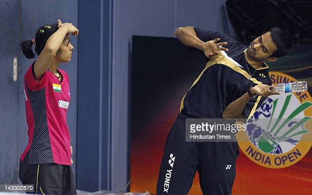 Indian Badminton Player Saina Nehwal along with her coach Gopichand during the practice session at Sri Fort Sports Complex on April 23 2012 in New...