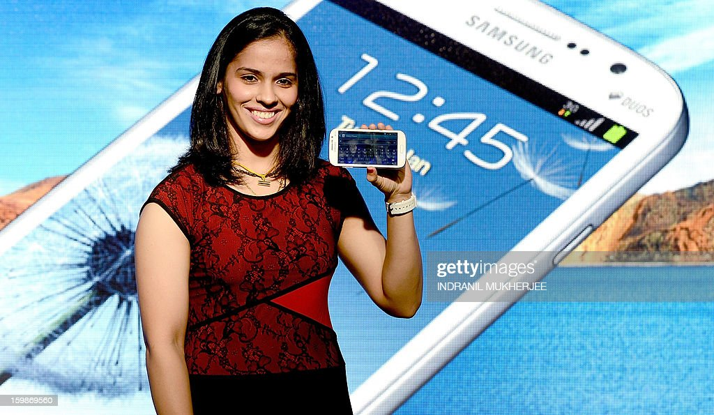 Indian Badminton player Saina Nehwal launches the Samsung Galaxy Grand smartphone at a function in Mumbai on January 22, 2013. The Galaxy Grand dual sim smartphone will retail for 21,500 rupees (USD 400) in the Indian market. AFP PHOTO/ INDRANIL MUKHERJEE