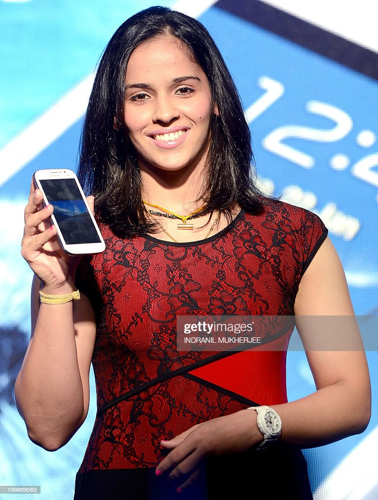 Indian Badminton player Saina Nehwal launches the Samsung Galaxy Grand smartphone at a function in Mumbai on January 22, 2013. The Galaxy Grand dual sim smartphone will retail for 21,500 rupees (USD 400) in the Indian market.
