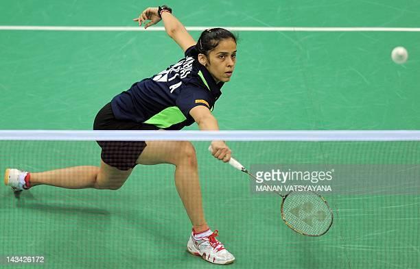 Indian Badminton player Saina Nehwal returns a shot against Bae Joo Youn of Korea during the YonexSunrise India Open 2012 at the Siri Fort Sports...