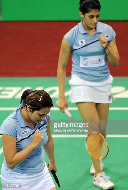 Indian Badminton players Jwala Gutta and Ashwini Ponnappa celebrate a point against Marissa Vita and Melati Nadya of Indonesia during the...