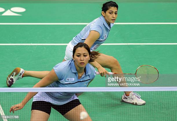 Indian Badminton players Jwala Gutta and Ashwini Ponnappa return a shot against Marissa Vita and Melati Nadya of Indonesia during the YonexSunrise...