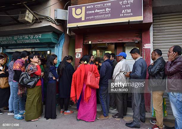Indian bank customers queue to try to withdraw money from an ATM Imphal the capital city of Indias northeastern state of Manipur on December 8 2016...