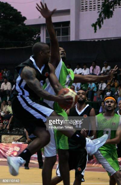 Indian Basket Ball USA in Black and Ongc in Green fights for the ball at basket ball match at Savio Cup All India Basket Ball Tornament 2009 at Don...