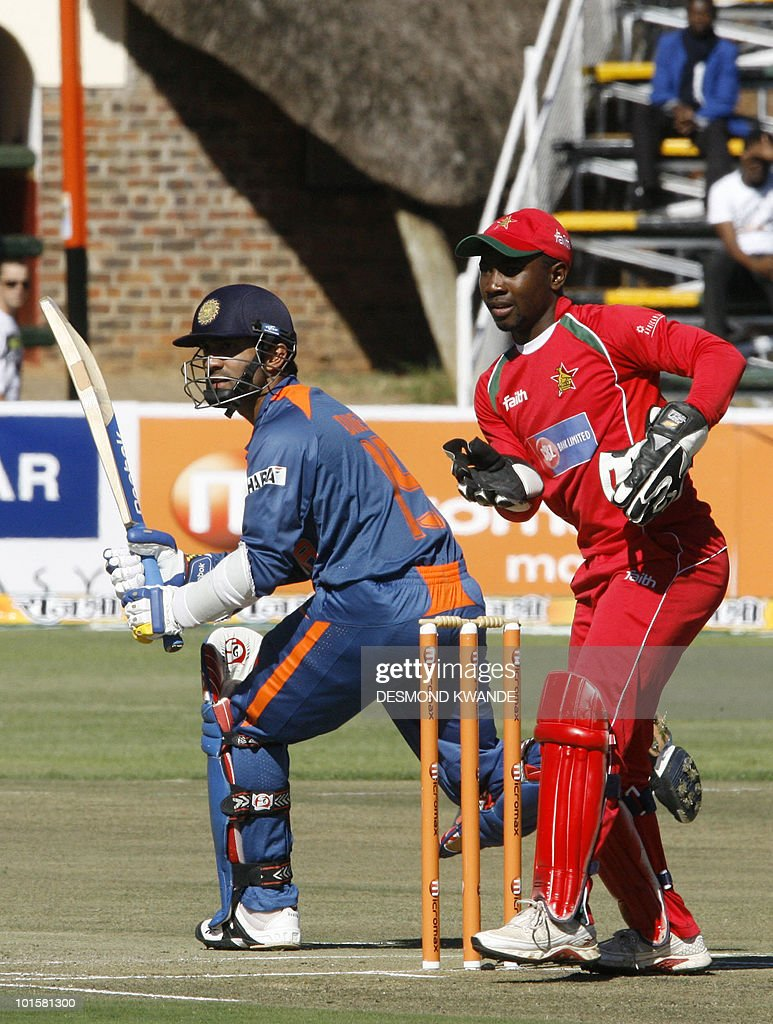 Indian batman Dinesh Karthik (L) waits to see if he is safe to make a run as Zimbabwean wicket keeper Tatenda Taibu awaits an opportunity for a run out at the Harare Sports Club on June 3, 2010 during a one-day international, part of a tri-nations series that includes Sri Lanka. AFP PHOTO / Desmond Kwande