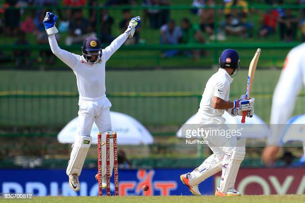 Indian batsman Ajinkya Rahane gets bowled out during the 1st Day's play in the 3rd Test match between Sri Lanka and India at the Pallekele...