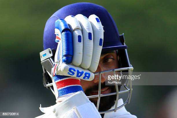 Indian batsman Ajinkya Rahane reacts after getting out during the 1st Day's play in the 3rd Test match between Sri Lanka and India at the Pallekele...