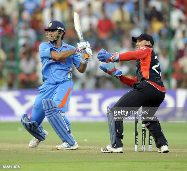 Indian batsman Dhoni hits the ball for 4 runs during the ICC Cricket World Cup match at Chinnaswamy Stadium Bangalore India