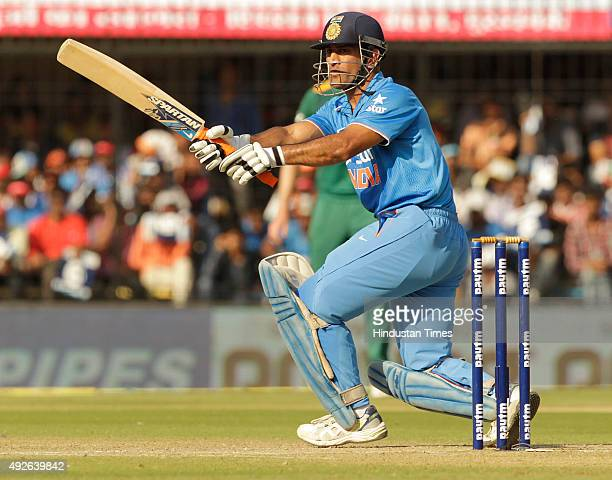 Indian batsman MS Dhoni plays a shot during the 2nd One Day cricket match against South Africa at Ushabai Holkar Stadium on October 14 2015 in Indore...