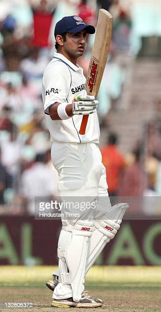 Indian batsman Gautam Gambhir raises his bat after scoring a halfcentury during the first day of second Test match between India and West Indies at...