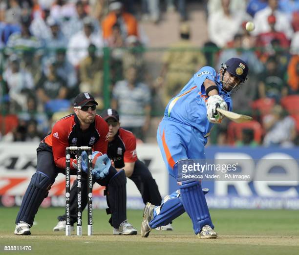 Indian batsman Guatam Gambhir hits the ball for 4 runs during the ICC Cricket World Cup match at Chinnaswamy Stadium Bangalore India