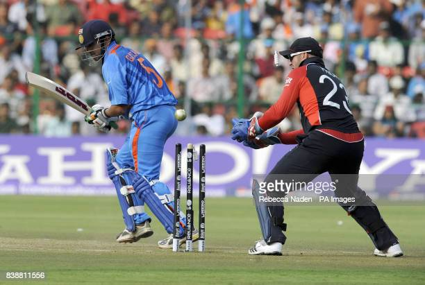 Indian batsman Guatam Gambhir is bowled by England's Graeme Swann during the ICC Cricket World Cup match at Chinnaswamy Stadium Bangalore India