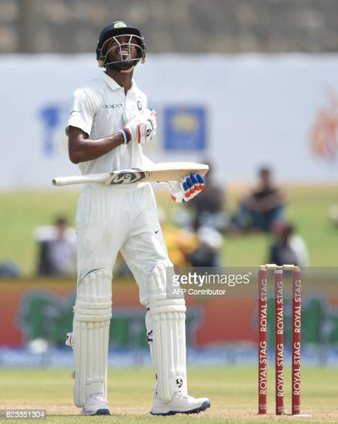 Indian batsman Hardik Pandya looks up after scoring 50 runs during the second day of the first Test match between Sri Lanka and India at Galle...