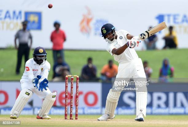 Indian batsman Hardik Pandya plays a shot during the second day of the first Test match between Sri Lanka and India at Galle International Cricket...