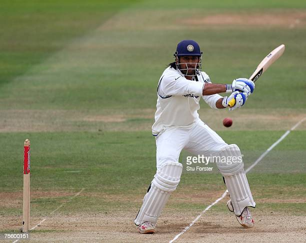 Indian batsman Mahendra Dhoni hits a boundary during day five of the First Test Match between England and India at Lords on July 23 2007 in London...