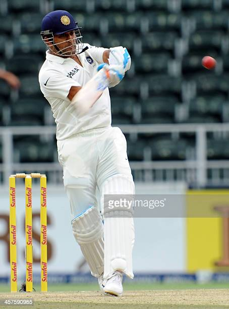 Indian batsman Mahendra Singh Dhoni plays a shot on the first day of the first cricket Test between SouthAfrica and India at the Wanderers Stadium in...