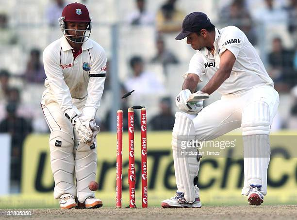 Indian batsman Rahul Dravid is bowled by West Indies bowler Kraigg Brathwaite during the first day of second Test match between India and West Indies...