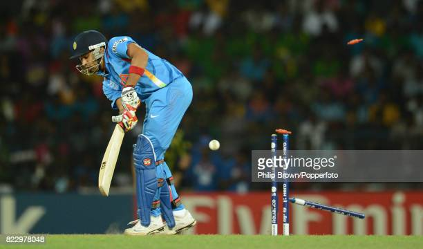 Indian batsman Rohit Sharma is bowled for 1 run by Australia's Mitchell Starc during the ICC World Twenty20 Super Eight match between Australia and...