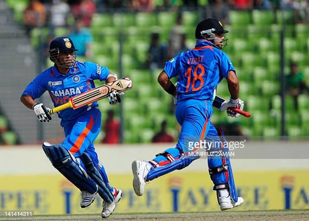 Indian batsman Sachin Tendulkar and his teammate Virat Kohli runs between the wickets during the one day international Asia Cup cricket match between...