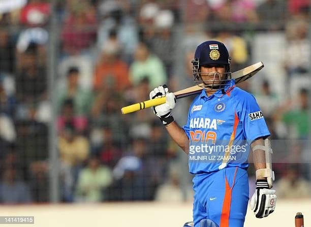 Indian batsman Sachin Tendulkar looks on during the one day international Asia Cup cricket match between India and Bangladesh at the ShereBangla...