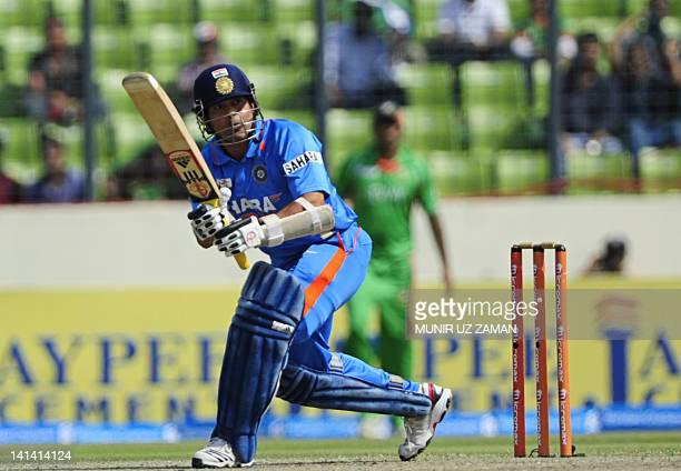 Indian batsman Sachin Tendulkar plays a shot during the one day international Asia Cup cricket match between India and Bangladesh at The ShereBangla...