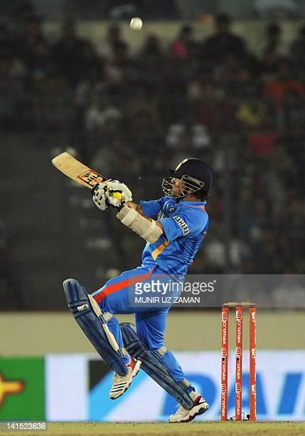 Indian batsman Sachin Tendulkar plays a shot during the one day international Asia Cup cricket match between India and Pakistan at The ShereBangla...