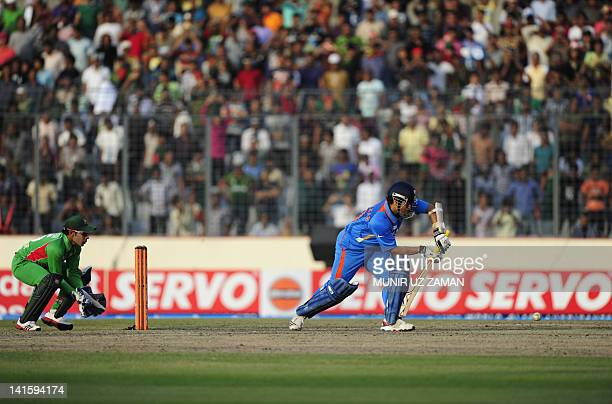 Indian batsman Sachin Tendulkar plays the shot to make his hundred century during the one day international Asia Cup cricket match between India and...