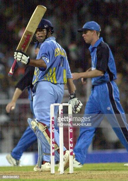 Indian batsman Sachin Tendulkar raises his bat towards the crowd after completing his half century during their third oneday match against England at...