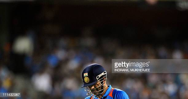 Indian batsman Sachin Tendulkar walks back to the pavilion after his dismissal during the ICC Cricket World Cup final between India and Sri Lanka at...