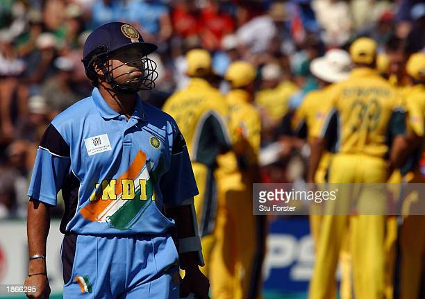 Indian batsman Sachin Tendulkar walks off after being caught and bowled by Glenn Mcgrath for 4 runs during the World Cup Final between Australia and...