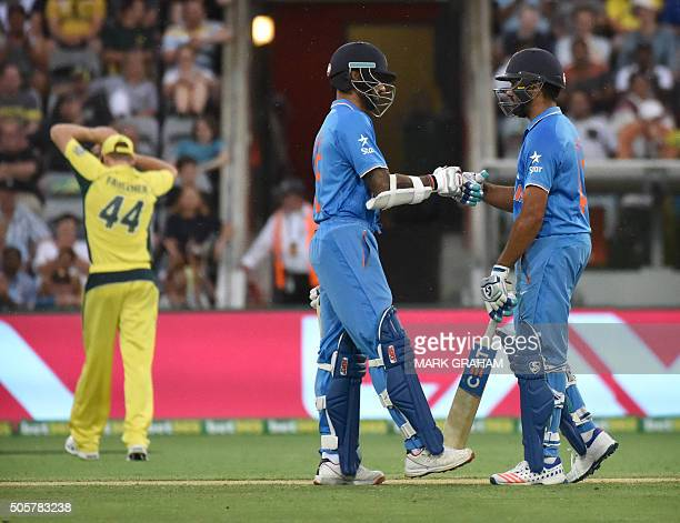 Indian batsman Shikhar Dhawan and Rohit Sharma knock gloves during the fourth oneday international cricket match between India and Australia at the...