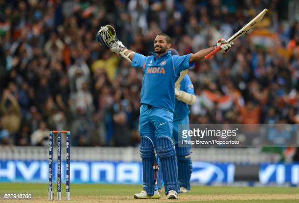 Indian batsman Shikhar Dhawan celebrates reaching his century during his innings of 102 not out in the ICC Champions Trophy group match between India...
