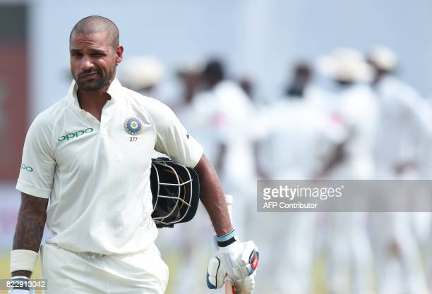 Indian batsman Shikhar Dhawan leaves the pitch after being dismissed during the first day of the first Test match between Sri Lanka and India at...