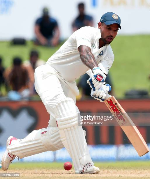 Indian batsman Shikhar Dhawan plays a shot during the first day of the first Test match between Sri Lanka and India at Galle International Cricket...