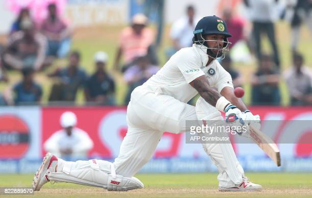 Indian batsman Shikhar Dhawan plays a shot during the first day of first Test match between Sri Lanka and India at Galle International Cricket...