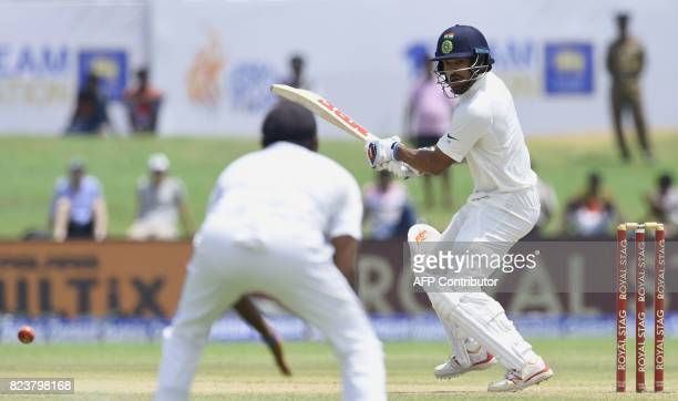 Indian batsman Shikhar Dhawan plays a shot during the third day of the first Test match between Sri Lanka and India at Galle International Cricket...