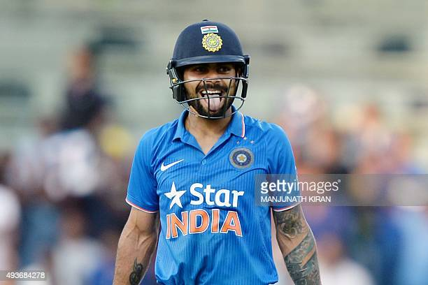 Indian batsman Virat Kohli gestures after playing a shot during the fourth one day international cricket match between India and South Africa at The...