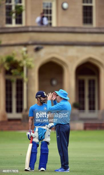 Indian batsman Virat Kolhi speaks with coach Duncan Fletcher in the nets during a training session in Adelaide on February 13 2015 ahead of their...