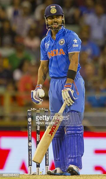 Indian batsman Virat Kohli waits on an appeal during the 2015 Cricket World Cup Pool B match between the West Indies and India in Perth on March 6...