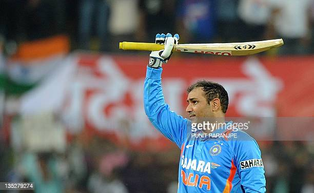 Indian batsman Virender Sehwag celebrates after scoring a double century during the fourth oneday international cricket match between India and West...