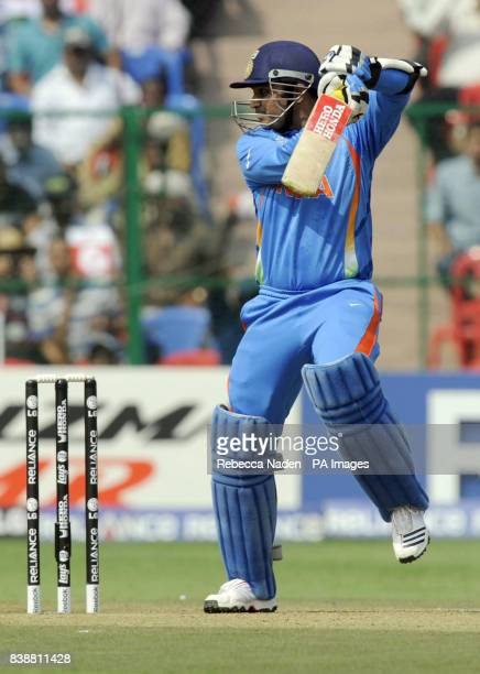 Indian batsman Virender Sehwag hits the ball for 4 runs during the ICC Cricket World Cup match at Chinnaswamy Stadium Bangalore India