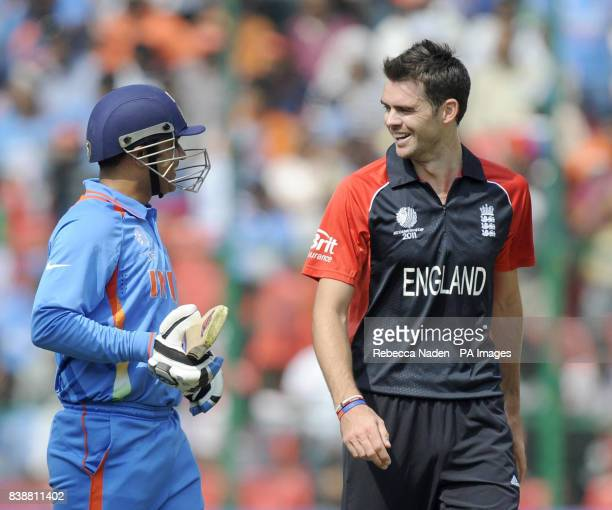 Indian batsman Virender Sehwag smiles with England bowler James Anderson during the ICC Cricket World Cup match at Chinnaswamy Stadium Bangalore India