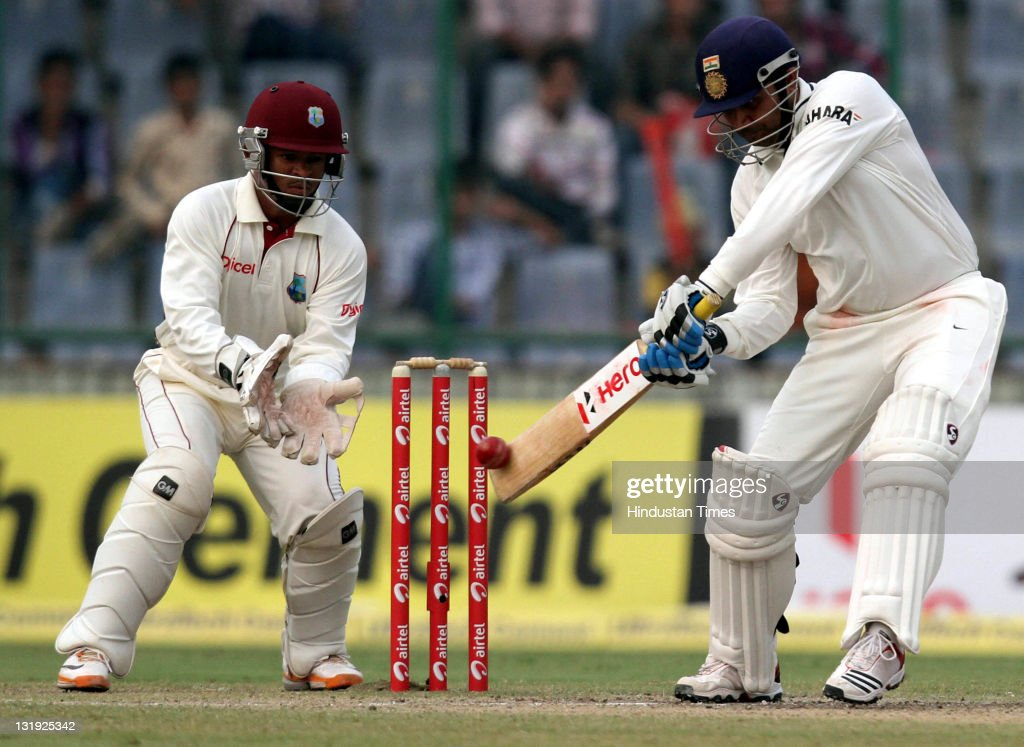 Indian batsman Virendra Sehwag plays a shot during the third day of the first test match between India and West Indies at the Feroz Shah Kotla stadium on November 8, 2011 in New Delhi, India.