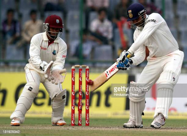 Indian batsman Virendra Sehwag plays a shot during the third day of the first test match between India and West Indies at the Feroz Shah Kotla...