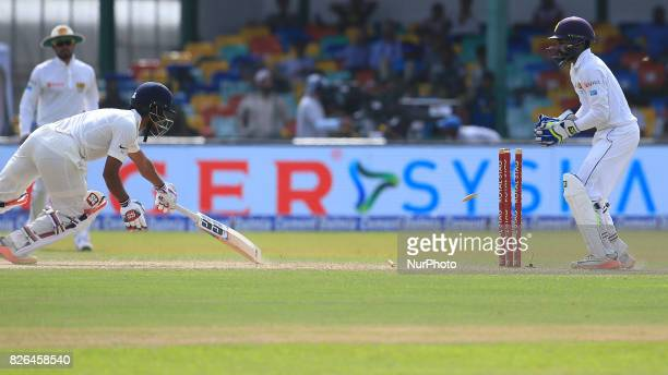 Indian batsman Wriddhiman Saha is stumped out by Sri Lankan wicket keeper Niroshan Dickwella during the 2nd Day's play in the 2nd Test match between...